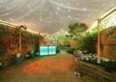 Academy Marquees Ed Buchannan Small but beautiful Notting Hill garden with Custom Covers ivory starlight linings on 3m legs with clear gable ends